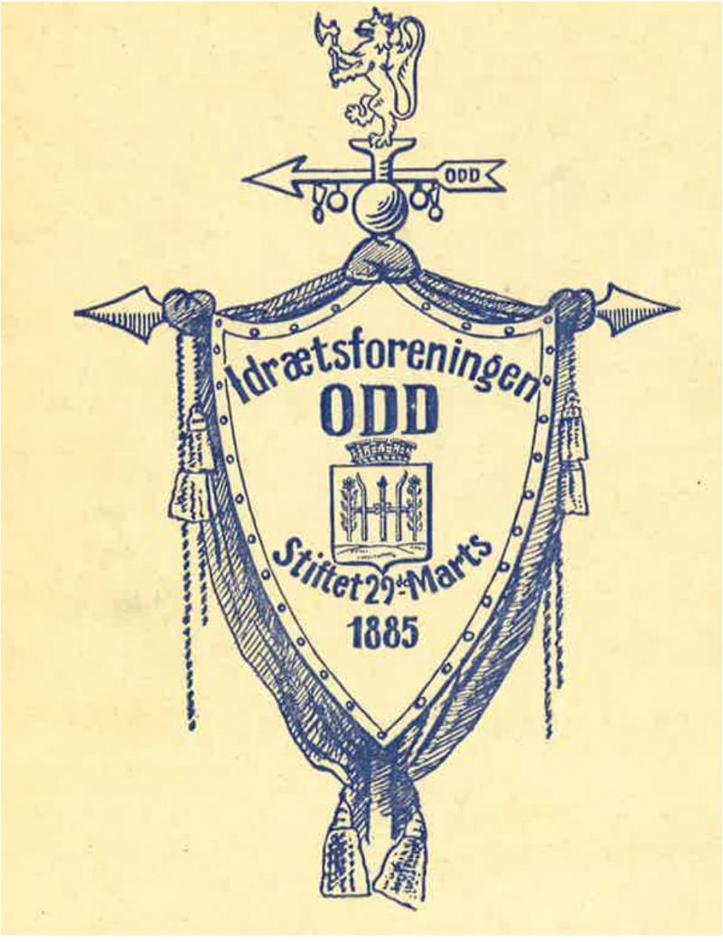 Løve på toppen, så fanepil og midt på står Skiens byvåpen (tegning i medlemsbladet 1929)